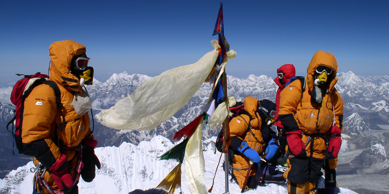 Sherpas on the summit of Mount Everest.